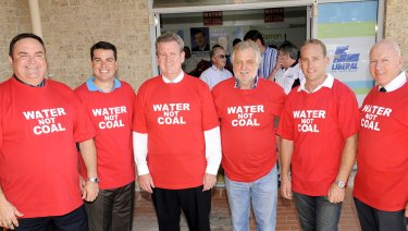 Premier Barry O'Farrell in 2011 with (from left) Chris Holstein (Member for Gosford), Darren Webber (Member for Wyong), Barry O'Farrell (Premier), Alan Hayes (Australian Coal Alliance), Chris Spence (Member for The Entrance) & Chris Hartcher (Member for Terrigal & Minister for Energy) wearing shirts protesting the mine. His government later approved the project.