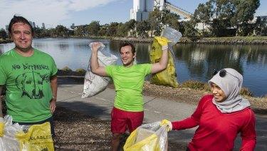 Having fun and doing good: Jamie Hughes, Derek Atkinson and Farah Rozhan 'plogging', or, picking up rubbish while jogging, along the Maribyrnong River, Footscray.