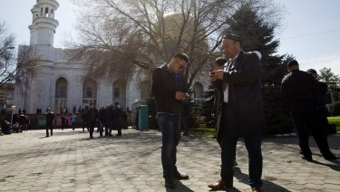 Omir Bekali, front right, now free, prepares to pray at a mosque in Almaty, Kazakhstan.
