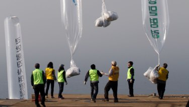 North Korean defectors and South Korean activists release balloons carrying leaflets condemning North Korean leader Kim Jong-il in 2010.