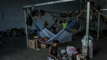 Families cook and rest at a migrant shelter exclusively for indigenous migrants in Pacaraima, Brazil.