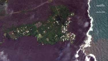 Lava flows on most of Kapoho Bay, creating a new foreshore.