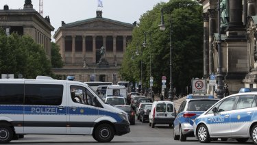 Police vehicles stand in front of Berlin Cathedral, after the attack.