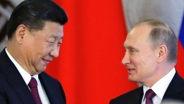Not the same: Russian President Vladimir Putin, right, and Chinese President Xi Jinping.