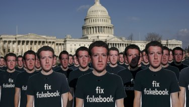 Cardboard cut outs of Mark Zuckerberg welcome him to the US Capitol where he testified for five hours on Tuesday.