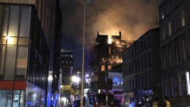 Flames rise from the Glasgow School of Art's Mackintosh Building.