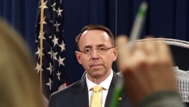 A reporter asks a question of  Deputy Attorney General Rod Rosenstein, after he announced that the office of special counsel Robert Mueller says a grand jury has charged 13 Russian nationals and several Russian entities.