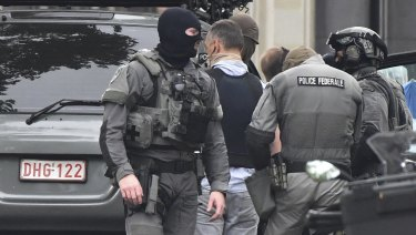 Belgian Special Police at the scene of a shooting in Liege on Tuesday.