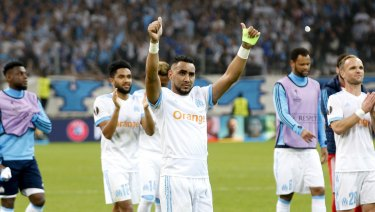 Solid showing: Dimitri Payet salutes the fans after Marseille's 2-0 win.