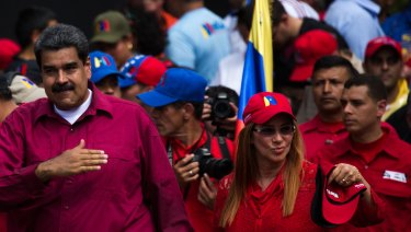 Venezuelan President Nicolas Maduro and his wife Cilia Flores attend a May Day rally on Tuesday.