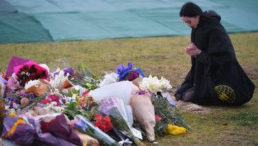 A woman pays her respects at the memorial for Eurydice Dixon in Princes Park.