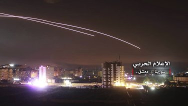Missiles rise into the sky as Israeli missiles hit air defence position and other military bases, in Damascus, Syria.