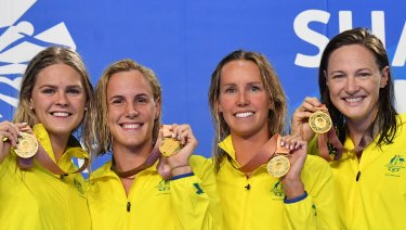 Golden smiles: Shayna Jack, Bronte Campbell, Emma McKeon and Cate Campbell after breaking the 4x100 metre freestyle relay world record.