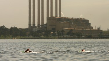 Up until the plant's closure in 2017 the waters in the pondage were warm, because warm water was pumped into it from the power station. Here, Grant Hackett swims in a competition in 2007.