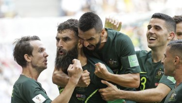 Captain courageous: Mile Jedinak channels Ned Kelly after nervelessly converting from the spot.