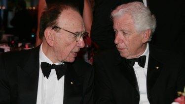 Rupert Murdoch and Frank Lowy deep in conversation in 2009.