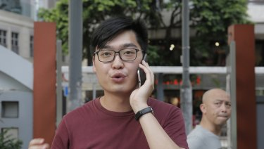 Leader of the Hong Kong National Party Andy Chan speaks on his mobile on Tuesday.