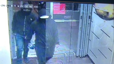 Peel Police tweeted this photo of two suspected entering the restaurant before detonating an improvised bomb.