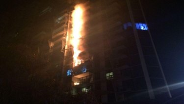 Fire fuelled by cladding roars up the Lacrosse apartment building in Docklands.