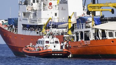 Migrants are transferred from the charity-run Aquarius to Spanish boats on June 12.