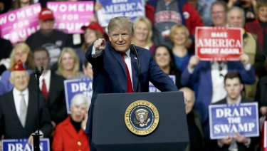 President Donald Trump at a campaign rally for Republican Rick Saccone on  Saturday, at which he mocked the idea of a commission achieving anything.