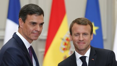 French President Emmanuel Macron, right, shakes hands with Spanish Prime Minister Pedro Sanchez after a joint press conference at the Elysee Palace on  Saturday.