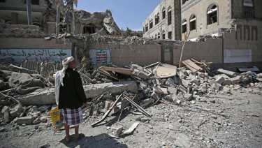 A man looks at damaged buildings after deadly air strikes in and near the presidential compound in Sanaa, Yemen, this month. The war has entered its fourth year.