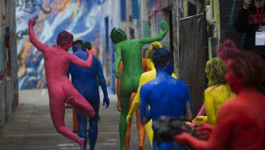 Colour my world: Exhilirated participants in a Spencer Tunick photo shoot - wearing only body paint - strode into Artists Lane in Windsor on Sunday.