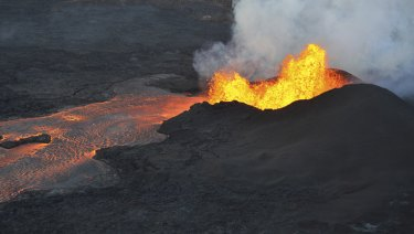 Lava spouts from a fissure near Pahoa in Hawaii on Tuesday.