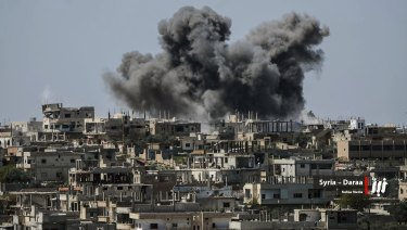 Smoke rises from buildings hit by Syrian government forces bombardment in Daraa province, southern Syria.