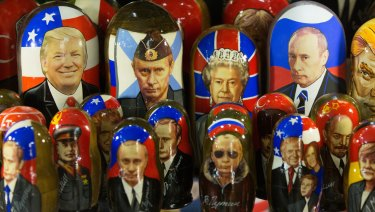 A gift shop displays souvenir matryoshka dolls decorated with the faces of Vladimir Putin, Donald Trump and Queen Elizabeth.