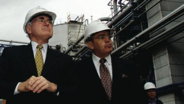 Manildra's Dick Honan (right) showing then prime minister John Howard around the company's ethanol plant in Bomaderry.