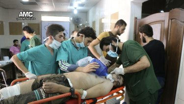 A man is treated by Syrian medical staff after a chemical weapons attack in 2016.