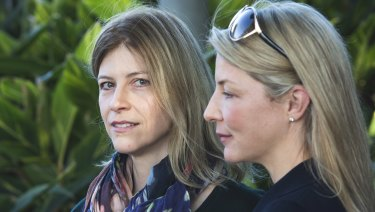 Twins Helen and Alison Telfer have both felt social pressure over their different childcare choices.