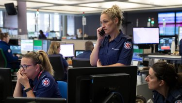 Staff at Sydney's ambulance control centre during a difficult call.