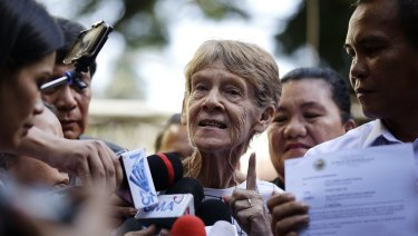Australian missionary Sister Patricia Fox gestures as she is interviewed by reporters after she was released from custody at the Bureau of Immigration in Manila.