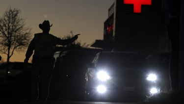 Texas troopers help redirect traffic near the site of another explosion in Austin on Tuesday.