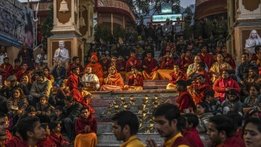 Religious students and tourists during a nightly ritual at the Parmath Niketan ashram in Rishikesh, India.