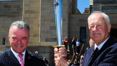 Dr Brendan Nelson, director of the Australian War Memorial and Alan Ferguson, chairman of Camp Gallipoli holding the RSL Anzac Flame that was presented to the Australian War Memorial in Canberra