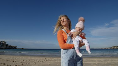 Annie Slattery, who immigrated from Ireland in 2009, with her baby daughter Romy at Bondi.
