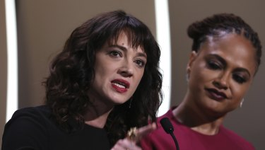 Actress Asia Argento, left, speaks about being raped by Harvey Weinstein, with jury member Ava Duvernay, during the closing ceremony of Cannes.
