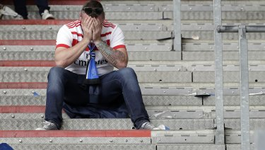 A devastated Hamburg fan after the match.