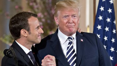 French President Emmanuel Macron, left, shows his affection for US President Donald Trump, at a news conference in Washington in April.