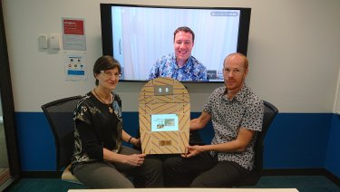Professor Janet Wiles, the robot Opie, Google's Daan Van Esch (on screen) and Ben Foley at Google HQ in Sydney.