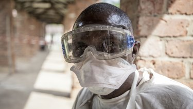A health worker wears protective clothing outside an isolation ward to diagnose and treat suspected Ebola patients, at Bikoro Hospital in Bikoro, the rural area where the Ebola outbreak was announced last week, in Congo.