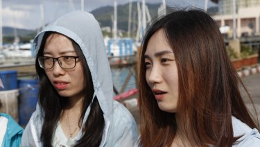 Chinese trainee doctors from Wuhan, Fang Han Yi, right, and Cheng Chi Lin.