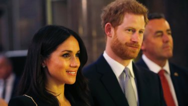 Prince Harry and Meghan Markle attend a reception at Australia House in London, Saturday, April 21.