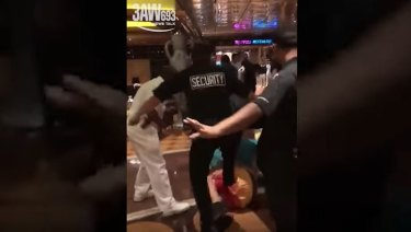 Mobile phone footage appears to show security guards kicking a passenger during the fight.
