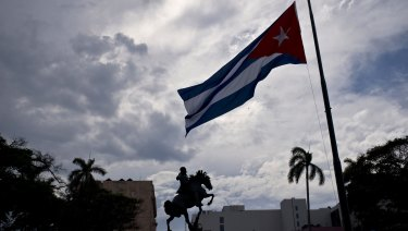 A Cuban flag is seen flying at half-mast, marking the start of two days of national mourning, in Havana on Saturday.