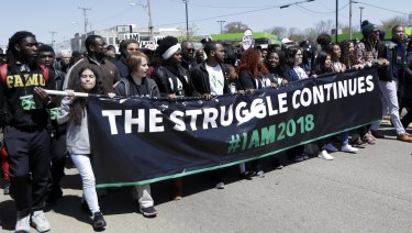 People march on the 50th anniversary of the assassination of Reverend Martin Luther King Jr.